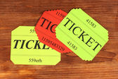 Colorful tickets on wooden background close-up — Stok fotoğraf