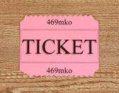 Colorful ticket on wooden background close-up — Stockfoto