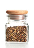 Jar of coriander seeds isolated on white — Stock Photo