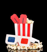 Popcorn with glasses and tickets isolated on black — Foto de Stock
