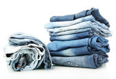 Lot of different blue jeans isolated on white — Stok fotoğraf