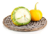 Two pumpkins on wicker mat isolated on white — Stock Photo