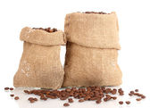 Coffee beans in bags isolated on white — Stock Photo