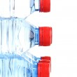 Plastic bottles of water isolated on white — Stock Photo #13395150