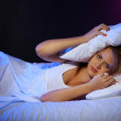 Young beautiful woman lying on bed in bedroom — Stock Photo #13395616
