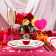 Ring in gift box on celebratory table  of Valentine's Day on white fabric background - Photo