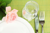 Table setting on a bamboo mat close-up — Stock Photo