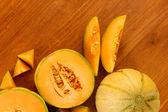 Cut melon on wooden background close-up — Stock Photo