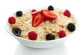 Tasty oatmeal with berries, isolated on white — Stock Photo
