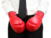 Businessman in boxing gloves isolated on white — Stock Photo