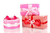 Colorful red and pink gifts isolated on white — Stock Photo