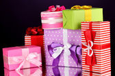 Colorful gifts on purple background — Stockfoto