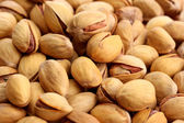 Tasty pistachio nuts, close up — Stock Photo