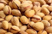 Tasty pistachio nuts, close up — Stock Photo