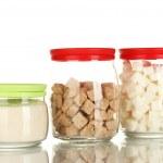 ������, ������: Jars with brown cane sugar lump white crystal sugar and white lump sugar isolated on white