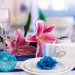 Serving fabulous wedding table in purple and blue color of the restaurant background — Stock Photo #13484628