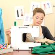 Beautiful young dressmaker in workroom — Foto de Stock