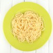 Royalty-Free Stock Photo: Italian spaghetti in plate on wooden table