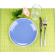 Table setting on a bamboo mat — Stock Photo #13485745