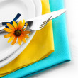 Knife, fork and flower on plate, isolated on white — Stock Photo