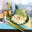 Royalty-Free Stock Photo: Plate with coleslaw and seasonings on wooden table on room background