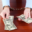 Businessmin handcuffs counts money for bribes — Stock Photo #13486446