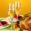 Banquet table with roast chicken on orange background close-up. Thanksgivin — Stock Photo