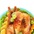 Whole roasted chicken with lettuce, grapes, oranges and spices on blue plat — Stock Photo