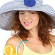Stock Photo: Smiling beautiful girl with beach hat and cocktail isolated on white