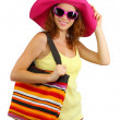 Smiling beautiful girl with beach hat and bag isolated on white - Stock Photo