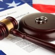 Divorce decree and wooden gavel on american flag background — Stock Photo #13488509
