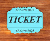 Colorful ticket on wooden background close-up — Stok fotoğraf