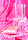 Wedding accessories on pink cloth background — Stock Photo