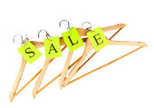 Coat hangers with sale tag isolated on white background — Stock Photo