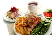 Roast chicken cutlet with boiled potatoes and vegetables, cup of tea and dessert, isolated on white — Stock Photo