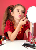 Little girl in her mother's dress, is trying painting her eyelashes — Stock Photo
