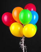 孤立在黑色的彩色气球 — 图库照片