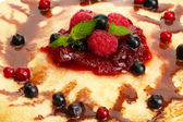 Delicious pancakes with berries and jam — Stock Photo