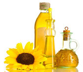 Oil in jars and sunflower, isolated on white — Stock Photo
