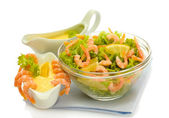 Salad with shrimps, lemon and lettuce leaves in bowl and sauce, isolated on — Stock Photo