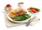 Roast chicken cutlet with boiled potatoes and vegetables, cup of tea and d — Stock Photo