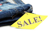 Fashion blue jeans on sale close-up isolated on white — Stock Photo