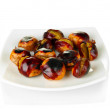 Stock Photo: Roasted chestnuts in the white plate with fork and knife isolated on white