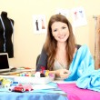 Beautiful young dressmaker in workroom — Stock Photo #13536964