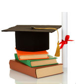 Grad hat and diploma with books isolated on white — Stock Photo