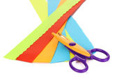 Colorful zigzag scissors with color paper isolated on white — Stock Photo