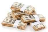 成堆的白色上孤立的一百美元钞票特写 — 图库照片