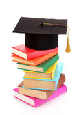 Grad hat with books isolated on white — Foto Stock