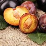 Rip plums on sacking — Stock Photo