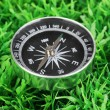 Stock Photo: Compass on green grass